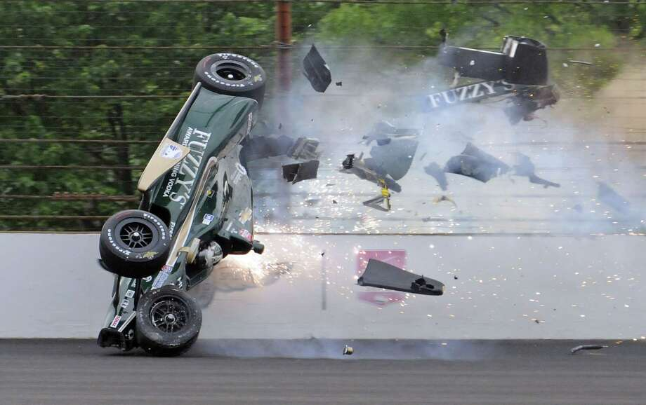 Ed Carpenter hits the wall in the second turn during practice before qualifications for the Indianapolis 500 auto race at Indianapolis Motor Speedway in Indianapolis on Sunday, May 17, 2015. Carpenter walked away from the crash and has been released from he track hospital after being checked. Photo: AP Photo/Greg Huey  / AP