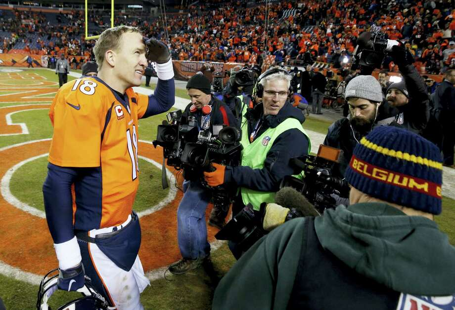 Broncos quarterback Peyton Manning leaves the field after beating the Steelers on Sunday. Photo: Jack Dempsey — The Associated Press  / FR42408 AP