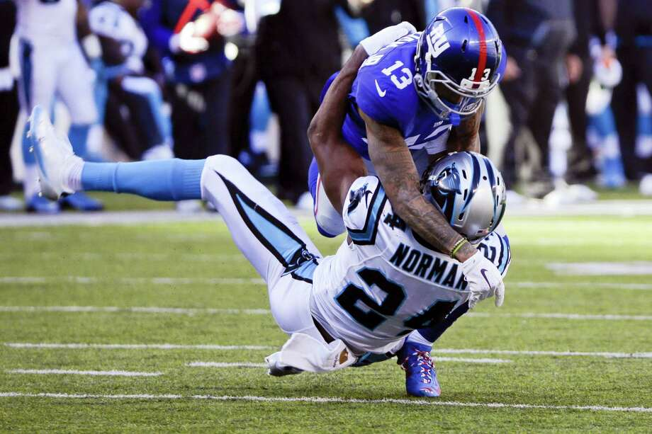 New York Giants wide receiver Odell Beckham (13) and Carolina Panthers' Josh Norman (24) grapple during the first half of last year's game at MetLife Stadium. Photo: The Associated Press File Photo   / Copyright 2016 The Associated Press. All rights reserved.
