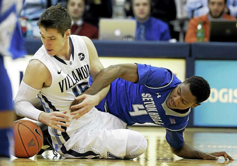 Villanova's Ryan Arcidiacono, left, battles for a loose ball with Seton Hall's Sterling Gibbs during a game in February. Photo: The Associated Press File Photo  / AP