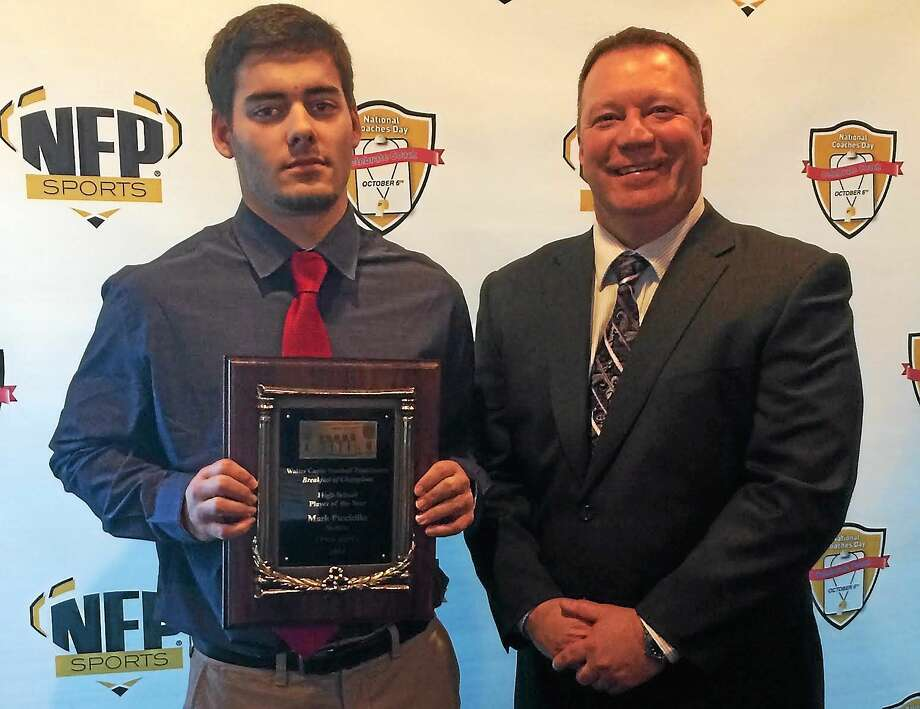 Shelton's Mark Piccirillo shows off his Walter Camp State Player of the Year award alongside Gaels coach Jeff Roy. Photo: Sean Patrick Bowley — Register