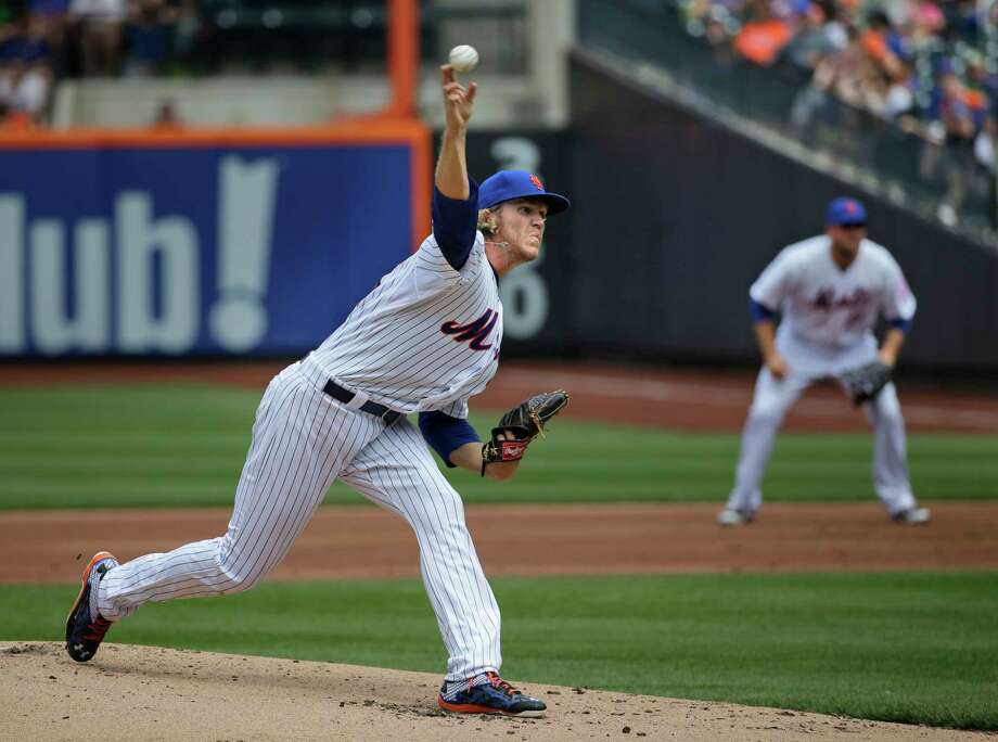 Mets pitcher Noah Syndergaard picked up his first major league win on Sunday. Photo: Seth Wenig — The Associated Press  / AP