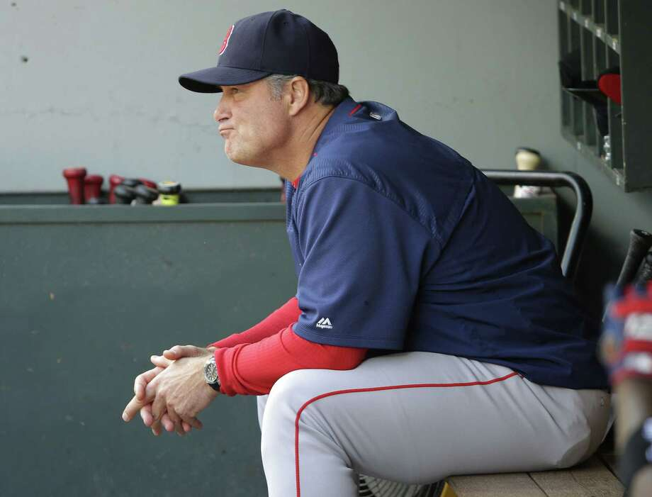 Red Sox manager John Farrell sits in the dugout during the eighth inning Sunday. Photo: Ted S. Warren — The Associated Press  / AP
