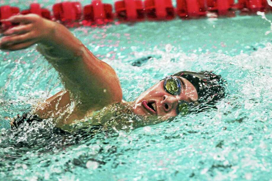 Senior Lauren Jamieson was among the Torrington swimmers who kept the Red Raiders close in their win over Holy Cross Wednesday night. Photo: Photo By Marianne Killackey  / 2015