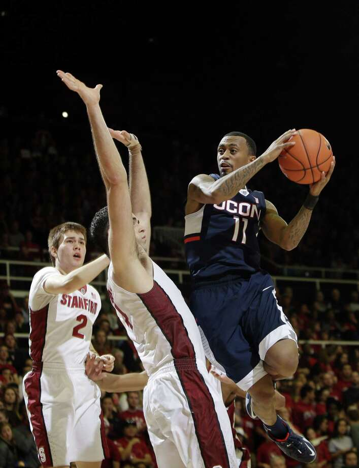 UConn's guard Ryan Boatright, right, shoots over Stanford center Stefan Nastic on Saturday. Photo: The Associated Press  / AP