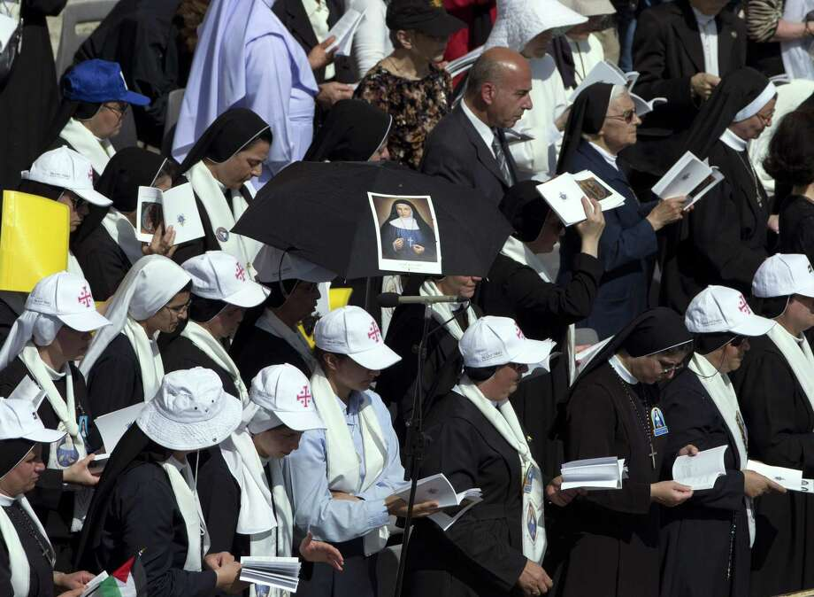 Nuns attend a canonization ceremony of four new saints led by Pope Francis  in St. Peter's Square at the Vatican on Sunday, May 17, 2015. Among them are Arab nuns Sts. Mariam Bawardy and Marie Alphonsine Ghattas, who lived in what was Ottoman-ruled Palestine in the 19th century. Photo: AP Photo/Alessandra Tarantino  / AP