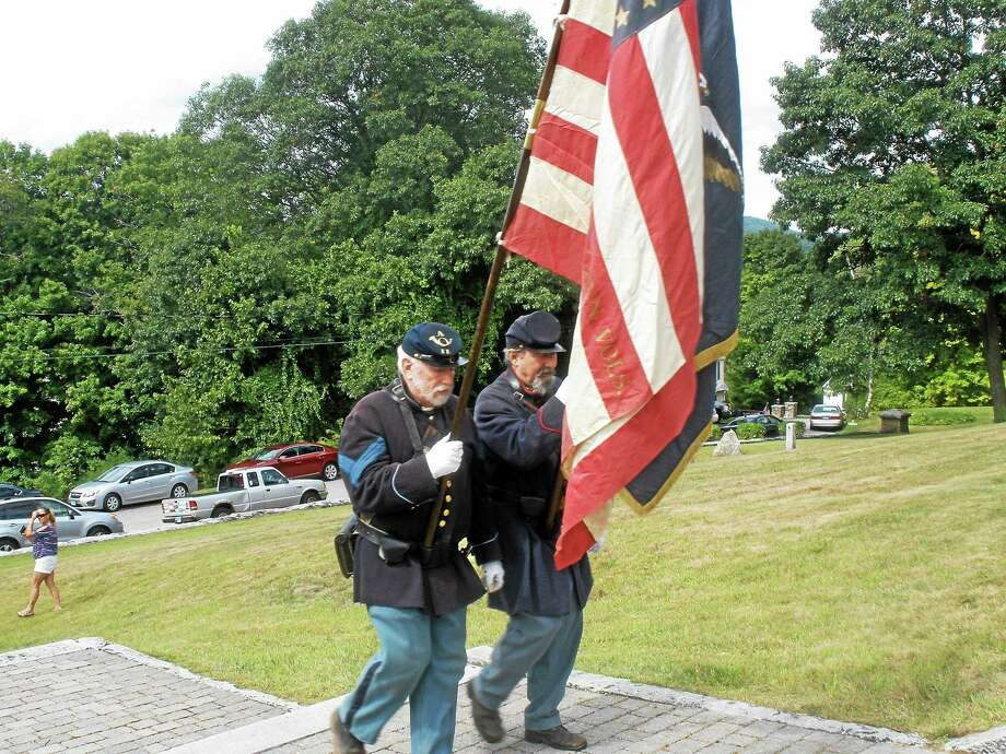Residents arrive to the annual rededication ceremony at the Soldiers' Monument and Memorial Park. This year's celebration commemorated the 125th anniversary of the monument's construction. Photo: Stephen Underwood — Register Citizen