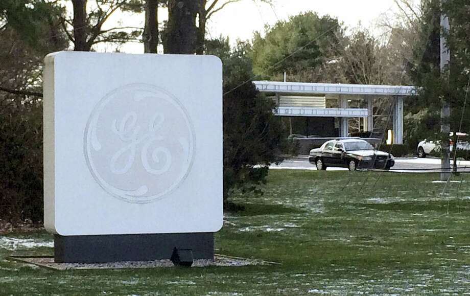 The GE logo adorns a sign on the General Electric Co., corporate headquarters campus on Jan. 14, 2016 in Fairfield, Conn. General Electric announced it will move its headquarters from Fairfield to the Seaport District of Boston. Photo: AP Photo/Michael Melia  / AP