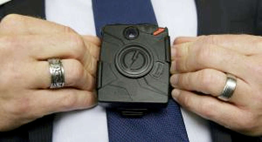 In this Feb. 19, 2015 photo, Steve Tuttle, vice president of communications for Taser International, demonstrates one of the company's body cameras for The Associated Press. Photo: AP Photo/Rich Pedroncelli  / AP