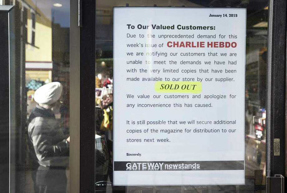 A sign notifying the public that the latest issue of the Charlie Hebdo magazine is sold out is posted on the storefront of Gateway Newstands in Toronto on Friday. Photo: AP Photo  / The Canadian Press
