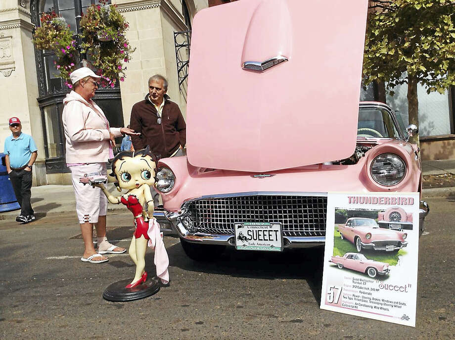 Contributed photoA fan admires a 1957 Thunderbird at last year's car show in New Britain. Photo: Journal Register Co.