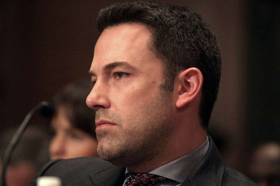 In this March 26, 2015 photo, actor Ben Affleck appears on Capitol Hill in Washington after testifying before the Senate State, Foreign Operations, and Related Programs subcommittee hearing on diplomacy. Photo: AP Photo/Lauren Victoria Burke, File  / FR132934 AP