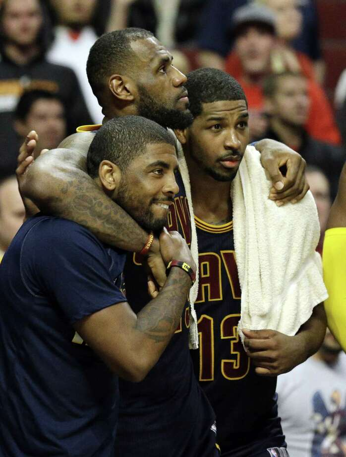 The Cleveland Cavaliers' LeBron James, center, watches the end of Game 6 against the Bulls with Kyrie Irving, left, and Tristan Thompson on Thursday night in Chicago. Photo: Nam Y. Huh — The Associated Press  / AP