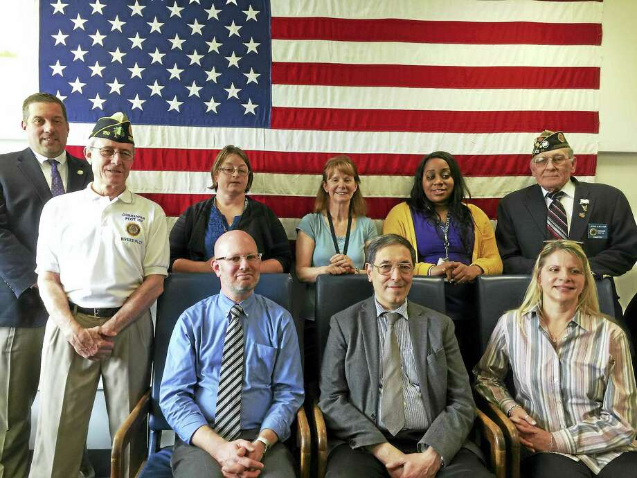 PHOTO BY BEN LAMBERT Two local American Legion posts recognized the work of staff members at the Winsted VA Clinic with a ceremony Friday. Photo: Journal Register Co.