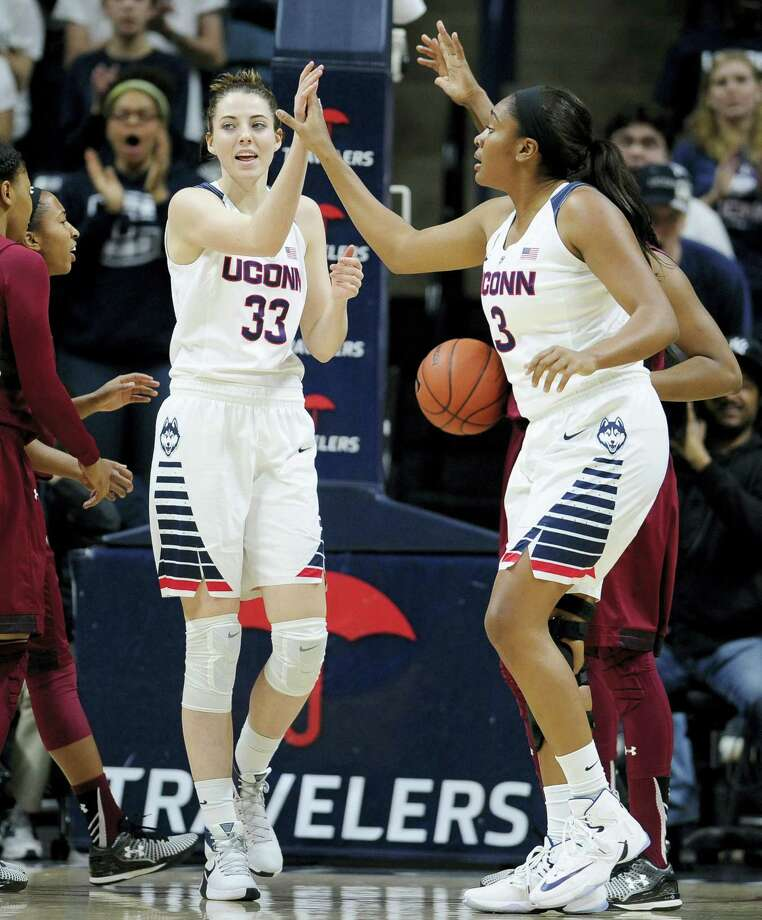 UConn's Katie Lou Samuelson, celebrates with teammate Morgan Tuck, right, in the first half Saturday. Photo: Jessica Hill — The Associated Press  / FR125654 AP