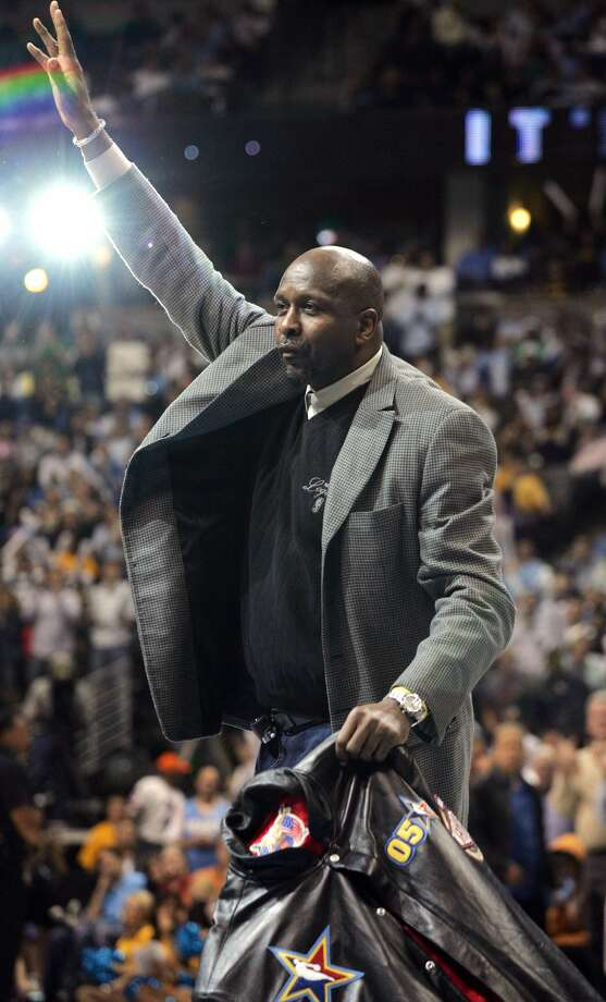 NBA Hall-of-Famer Moses Malone acknowledges the crowd during a break in Game 4 of the Clippers-Nuggets Western Conference first-round playoff series in Denver. Malone died Sunday at the age of 60. Photo: The Associated Press File Photo  / AP