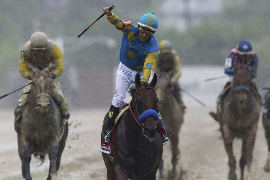 American Pharoah, ridden by Victor Espinoza, won the 140th Preakness Stakes on Saturday at Pimlico Race Course in Baltimore. Photo: Patrick Semansky — The Associated Press  / AP