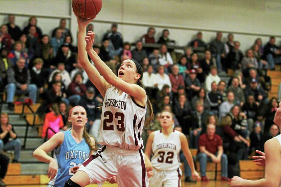 Torrington's Mia Barbieri goes up for a layup in her team's win over Oxford Friday night. Photo: Marianne Killackey — Special To Register Citizen  / 2014