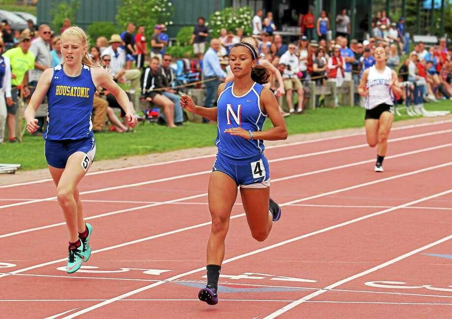 Michaela Pernell of Nonnewaug crosses the finish line for the 200 meter Photo: Marianne Killackey — Register Citizen  / 2014