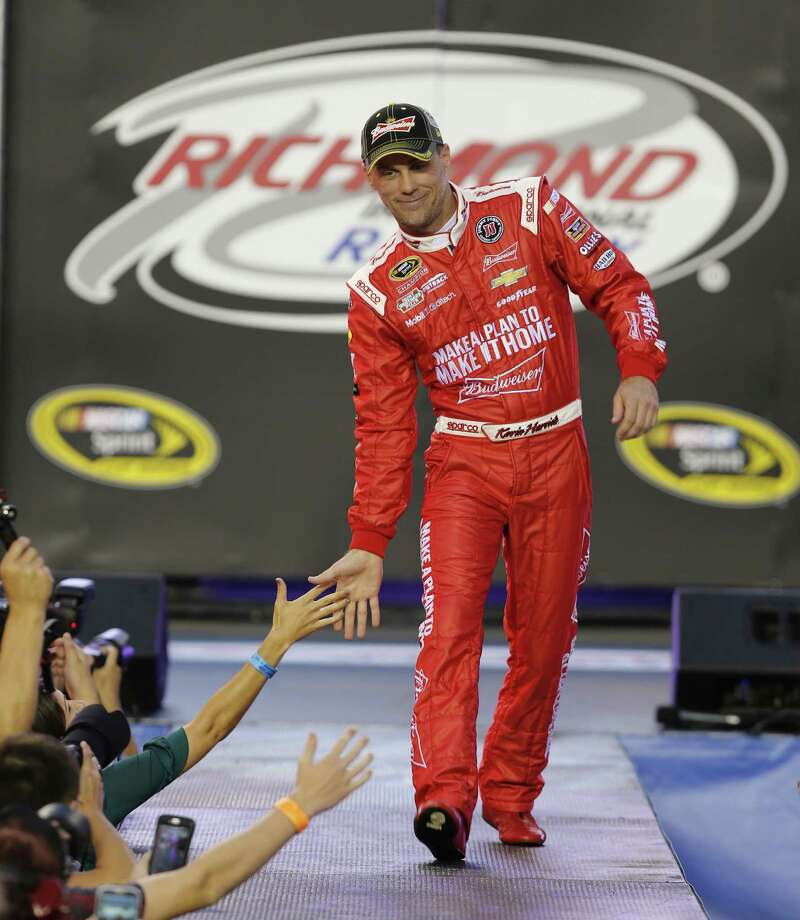 Sprint Cup Series driver Kevin Harvick (4) greets fans during driver introductions prior to the start of Saturday's race at Richmond International Raceway. Photo: Steve Helber — The Associated Press  / AP
