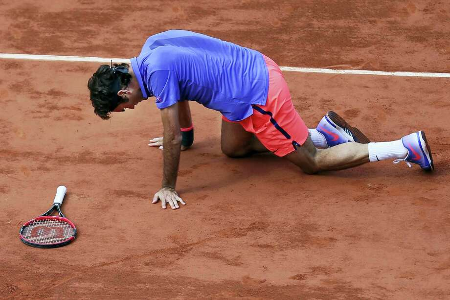 FILE- In this June 2, 2015 file photo, Switzerland's Roger Federer gets up after slipping in the quarterfinal match of the French Open tennis tournament against Switzerland's Stan Wawrinka at the Roland Garros stadium, in Paris, France. Swiss star Roger Federer has pulled out of the French Open because of concerns over the risk of injury. Photo: The Associated Press  / AP