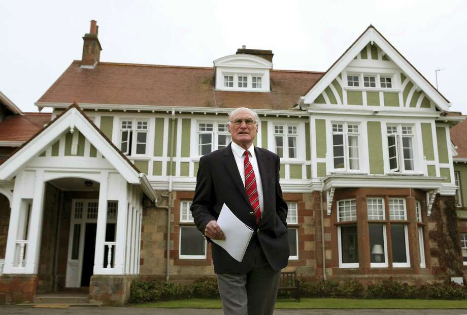 Andrew Milligan / PA  via The Associated Press Captain of Muirfield Golf Club, Henry Fairweather in front of Muirfield golf club clubhouse, as he makes an announcement on the outcome of a membership ballot, against admitting women as club members, Thursday May 19, 2016.  The Royal and Ancient, which organizes the British Open golf tournament has reacted Thursday by saying Muirfield will no longer be allowed to stage the major championship. Photo: AP / PA