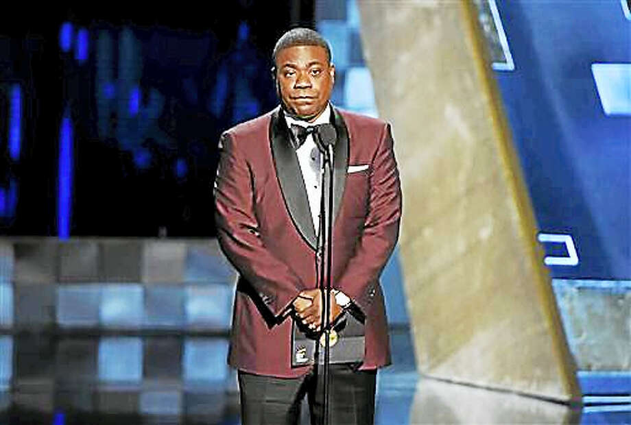 "In a Sunday, Sept. 20, 2015, file photo, Tracy Morgan presents the award for outstanding drama series at the 67th Primetime Emmy Awards, at the Microsoft Theater in Los Angeles. Morgan may soon be returning to regular television work at the FX network.FX announced that Morgan will develop and star in a comedy pilot about a career criminal trying to make it back into society after 15 years in prison. Morgan, the former ""30 Rock"" and ""Saturday Night Live"" comic, was seriously hurt in a New Jersey highway crash in June 2014. Photo: Photo By Chris Pizzello/Invision/AP   / Invision"