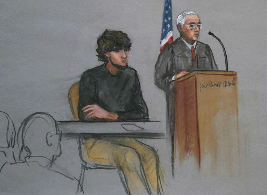 FILE - In this Monday, Jan. 5, 2015 file courtroom sketch, Boston Marathon bombing suspect Dzhokhar Tsarnaev, left, is depicted beside U.S. District Judge George O'Toole Jr., right, as O'Toole addresses a pool of potential jurors in a jury assembly room at the federal courthouse, in Boston. Two highly anticipated criminal trials are underway almost simultaneously in Massachusetts: the federal death penalty trial of Boston Marathon bombing suspect Dzhokhar Tsarnaev and the murder trial of former New England Patriots star Aaron Hernandez. (AP Photo/Jane Flavell Collins, File) Photo: AP / Jane Flavell Collins