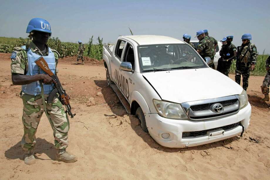 In this photo released by the United Nations African Mission in Darfur (UNAMID), UNAMID Force Commander Lt. General Patrick Nyamvumba from Rwanda inspects one of the UNAMID vehicles that suffered an ambush. Photo: AP File Photo  / UNAMID