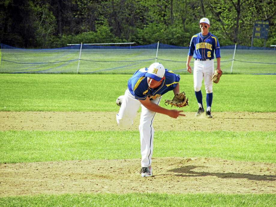Housatonic pitcher Zack Larson bears down with shortstop Scott Dignacco backing him up in a 2-1 Mountaineer win against Wamogo Thursday afternoon at Housatonic High School. Photo: Photo By Peter Wallace