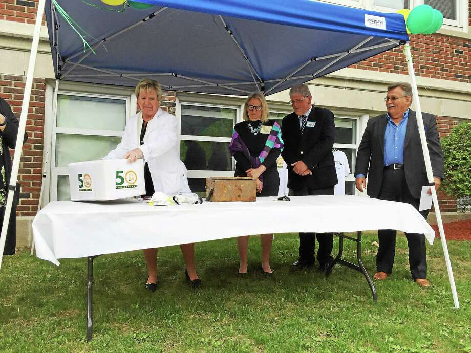 A time capsule buried in 1990 is opened as part of an open house commemorating NCCC's 50th anniversary. Photo: Ben Lambert — The Register Citizen