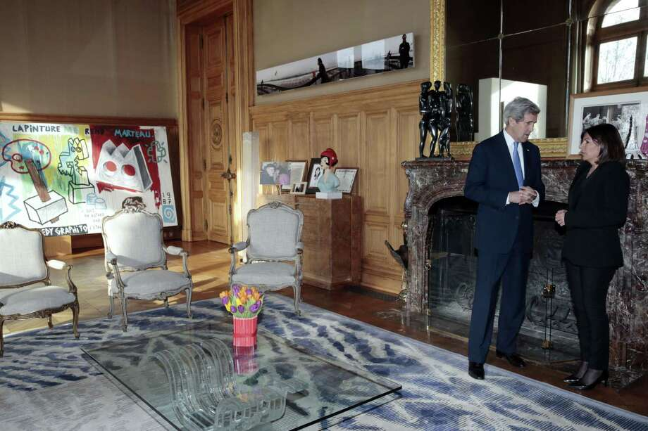 U.S. Secretary of State John Kerry, left, speaks with Paris Mayor Anne Hidalgo at Paris City Hall on Friday. U.S. Secretary of State John Kerry paid respect in both English and French on Friday to the victims of last week's terrorist attacks in Paris in a show of American solidarity with the French people. Photo: AP Photo  / POOL AFP