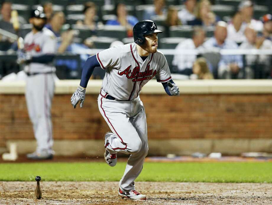 Atlanta Braves' Freddie Freeman (5) runs on his eighth-inning, single hit during a baseball game against the New York Mets on Sept. 19, 2016 in New York. Freeman had a first inning solo home run, a fourth-inning, two-run double and a seventh-inning, infield single. Photo: AP Photo/Kathy Willens  / Copyright 2016 The Associated Press. All rights reserved.