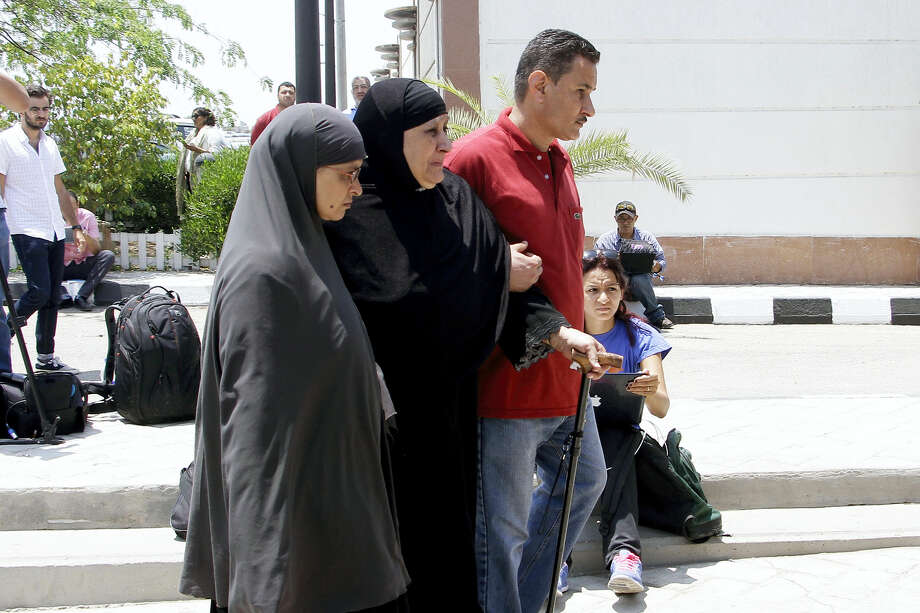 Relatives of passengers on an EgyptAir flight that crashed early Thursday walk past journalists at Cairo International Airport, Egypt, Thursday, May 19, 2016.  The EgyptAir jetliner bound from Paris to Cairo with 66 people aboard crashed in the Mediterranean Sea early Thursday after swerving wildly in flight, authorities said, and Egypt said it may have been a terrorist attack. Photo: AP Photo — Ahmed Abd El Fattah / Ahmed AbdEl fattah