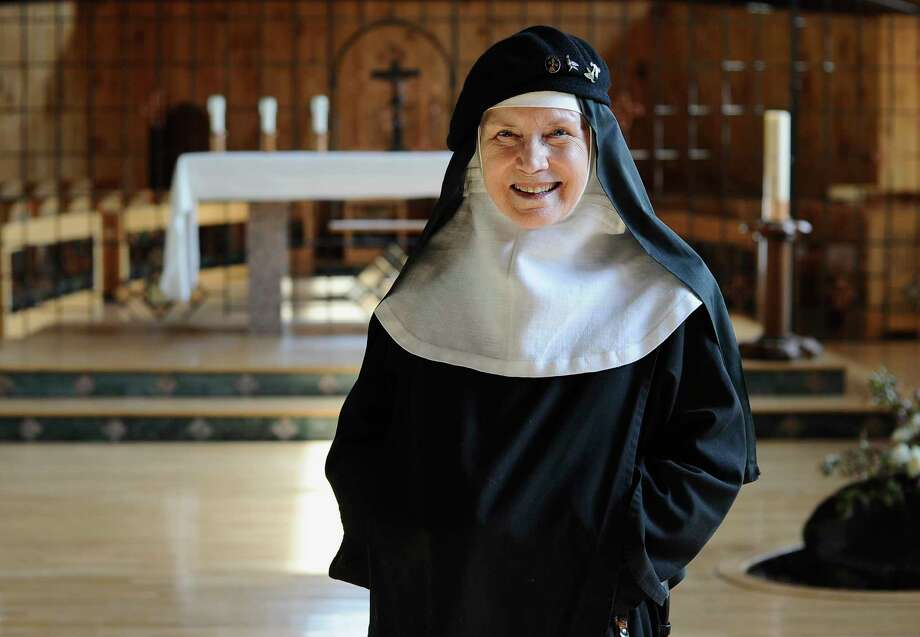 In this Friday, May 15, 2015 photo, Mother Dolores Hart poses for a photograph at the Abbey of Regina Laudis, in Bethlehem, Conn. Mother Dolores, a former actress who is best known for sharing the first on-screen kiss with Elvis Presley, has helped the Abbey which is in need of renovations gain exposure and aid from fans of Presley. (AP Photo/Jessica Hill) Photo: AP / FR125654 AP