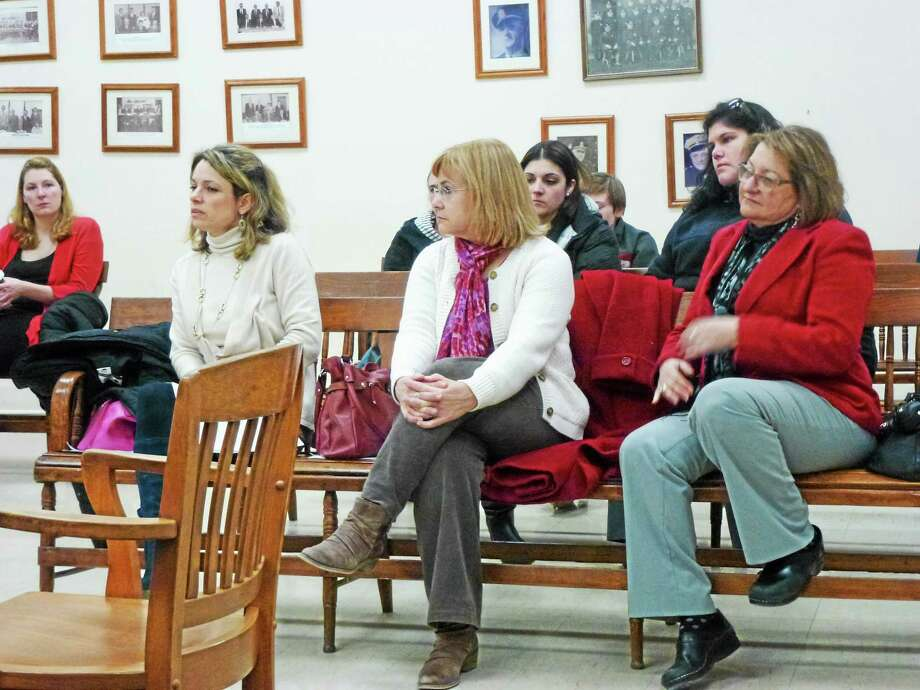 Winchester Public Schools principals, from left, Barbara Silverio, Holly Martin and Debra Grainsky attended Tuesday night's Board of Education meeting. Photo: Ryan Flynn — Register Citizen