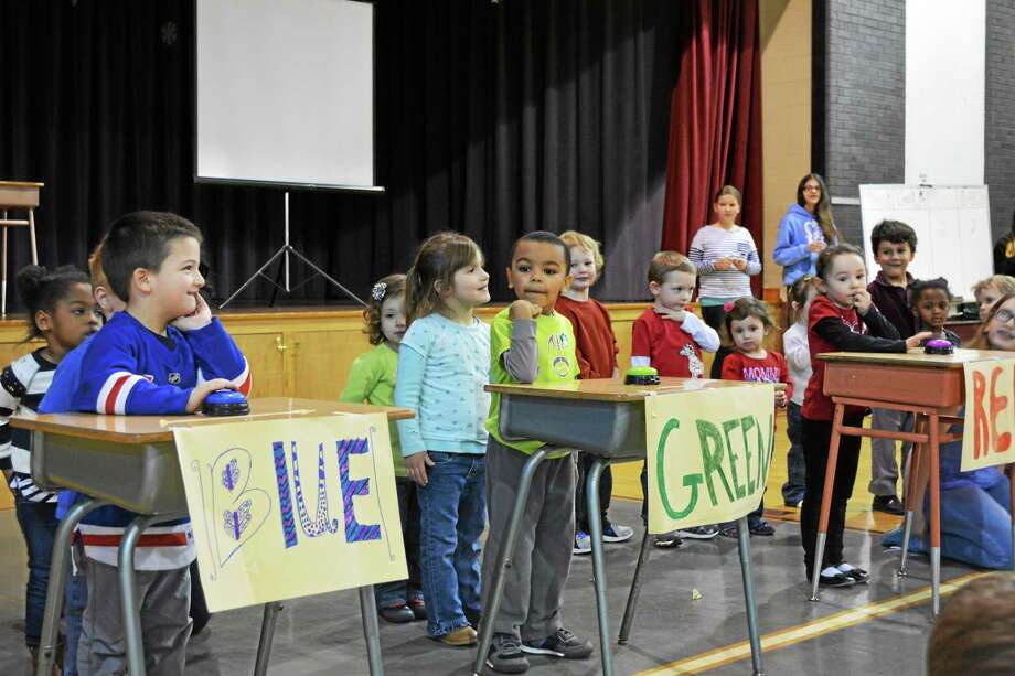 Students from St. Peter/St. Francis's fifth grade class and Pre-K class in Friday's Knowledge Bowl. Photo: Amanda Webster — The Register CitizEN