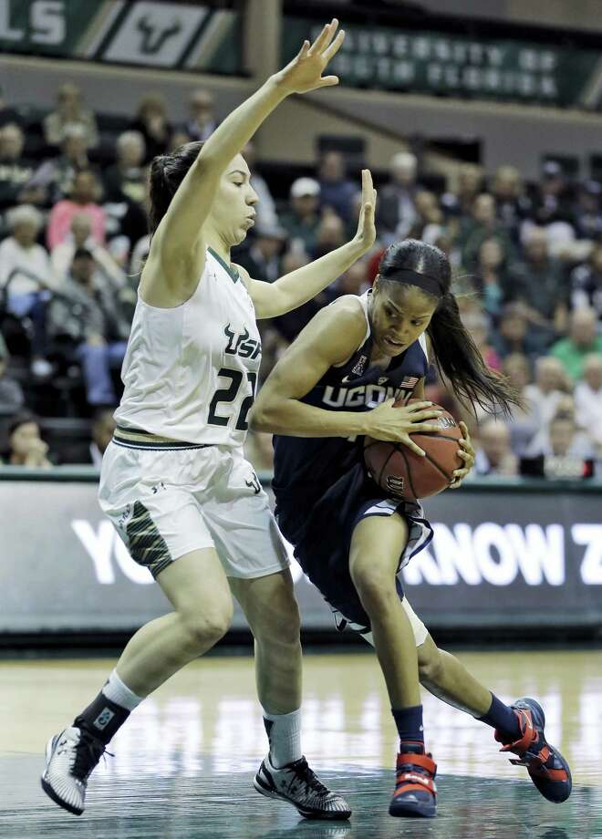 UConn guard Moriah Jefferson, right, drives to the basket during a recent game. Photo: The Associated Press File Photo  / AP