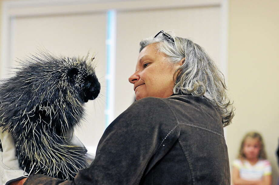 Naturalist Gerri Griswold talks about the habitat of porcupines in Connecticut during an event at the Barkhamsted Town Garage, featuring a porcupine called The New One. Photo: Register Citizen File Photo