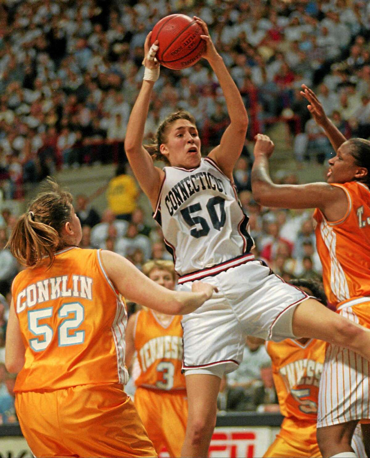 UConn's Rebecca Lobo pulls down a rebound between Tennessee's Abby Conklin and Tiffani Johnson during the Huskies' 77-66 win on Jan. 16, 1995, the first meeting between the storied programs.