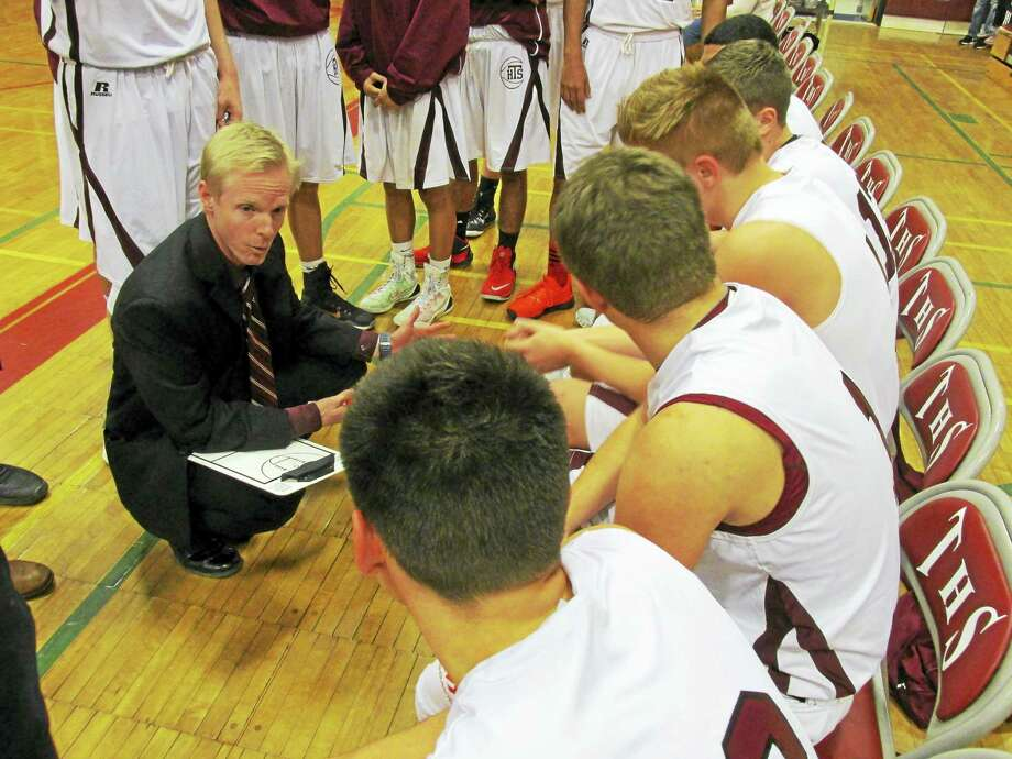 Torrington Coach Eric Gamari covers the bases with the Red Raiders in their win over Oxford Friday night. Photo: Peter Wallace - Register Citizen