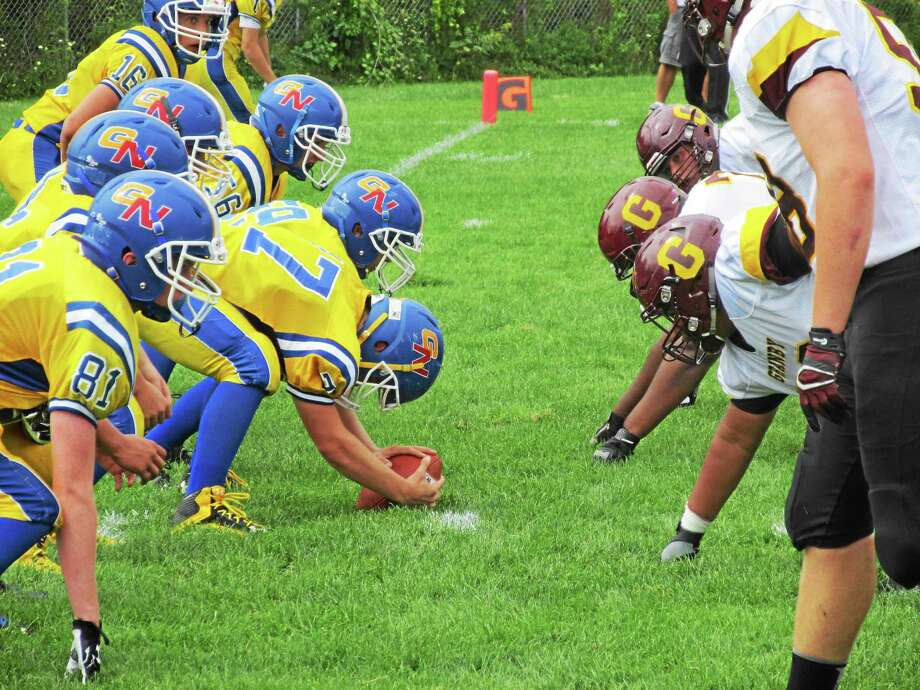 Granby Memorial's size difference on the line showed up big Saturday afternoon at Gilbert. Granby won 42-0. Photo: Peter Wallace ‑ Register Citizen