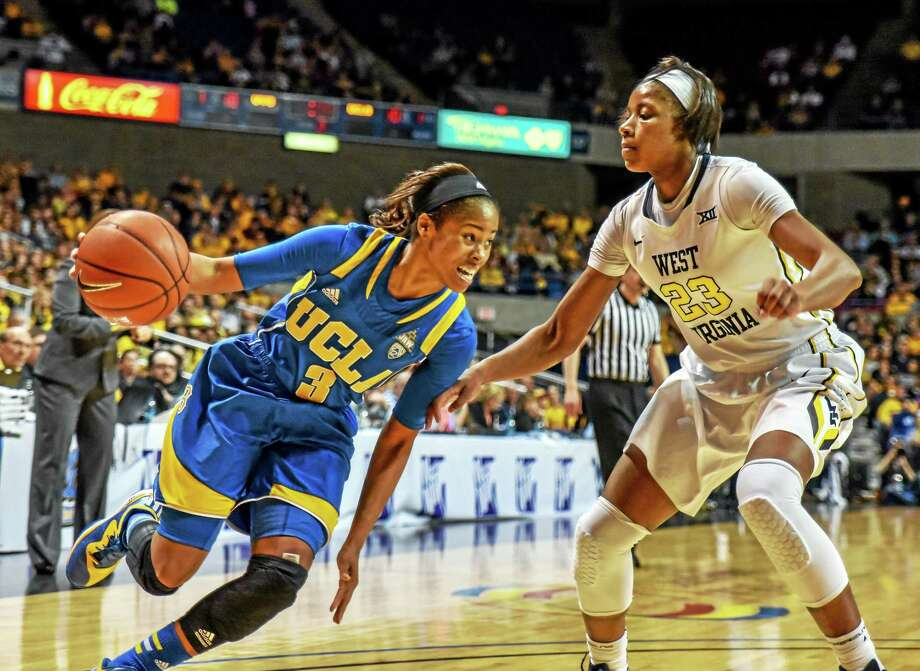 West Virginia's Bria Holmes, right, defends UCLA's Jordin Canada during the WNIT championship on April 4 in Charleston, W.Va. Photo: Tyler Evert — The Associated Press File Photo  / FR170609 AP