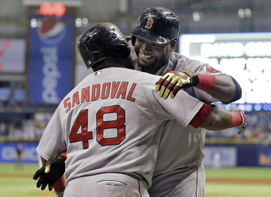 David Ortiz, right, hugs Pablo Sandoval after Ortiz hit his 500th career home run on Saturday. Photo: Chris O'Meara — The Associated Press  / AP