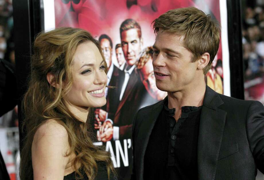 """In this June 5, 2007, file photo, Angelina Jolie and Brad Pitt arrive at the premiere of """"Ocean's Thirteen"""" in Los Angeles, Calif. Angelina Jolie Pitt has filed for divorce from Brad Pitt, bringing an end to one of the world's most star-studded, tabloid-generating romances. An attorney for Jolie Pitt, Robert Offer, said Tuesday, Sept. 20, 2016, that she has filed for the dissolution of the marriage. Photo: AP Photo/Chris Pizzello, File   / 2007 AP"""