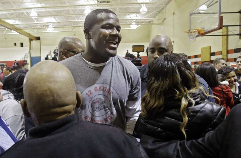 Ohio State quarterback Cardale Jones leaves a news conference Thursday in Cleveland after announcing he would not declare for the 2015 NFL draft. Photo: Mark Duncan — The Associated Press  / AP