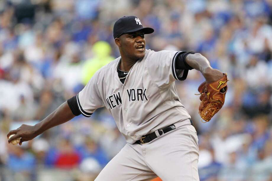 New York Yankees pitcher Michael Pineda throws in the first inning of a baseball game against the Kansas City Royals at Kauffman Stadium in Kansas City, Mo., Friday, May 15, 2015. (AP Photo/Colin E. Braley) Photo: The Associated Press  / FR123678 AP
