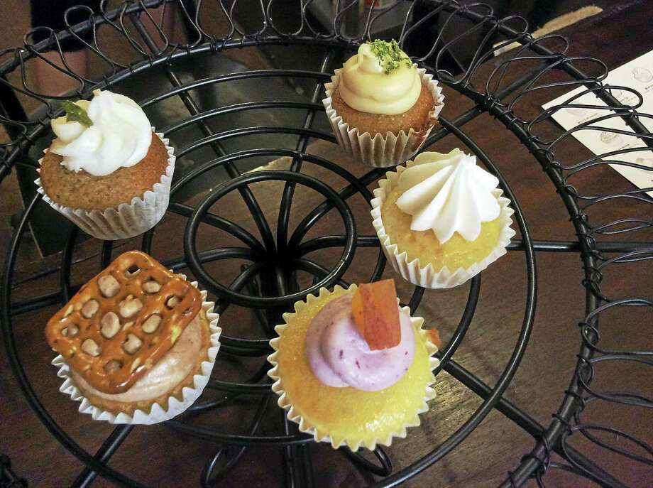 A selection of cupcakes from Prohibition Bakery, clockwise from top right, Dark & Stormy, Birthday Cake, Basic Bitch, Pretzels & Beer and Mint Julep. Photo: Stephen Fries — Special To The Register