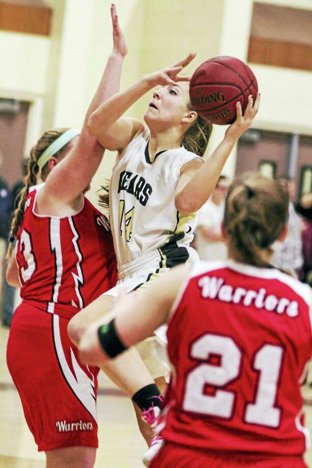 Thomaston forward Morgan Sanson shows Golden Bear strength heading for the basket. Photo: Photo By Marianne Killackey  / 2015