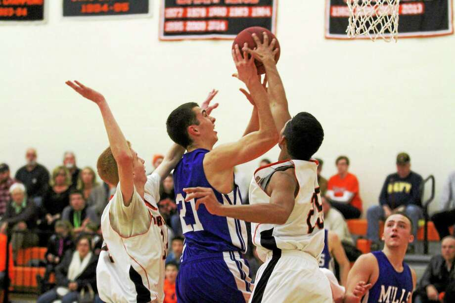 Marianne Killackey - Special to Register Citizen Lewis Mills' Nate Cook goes up for a shot against Terryville Thursday night. Photo: Journal Register Co. / 2014